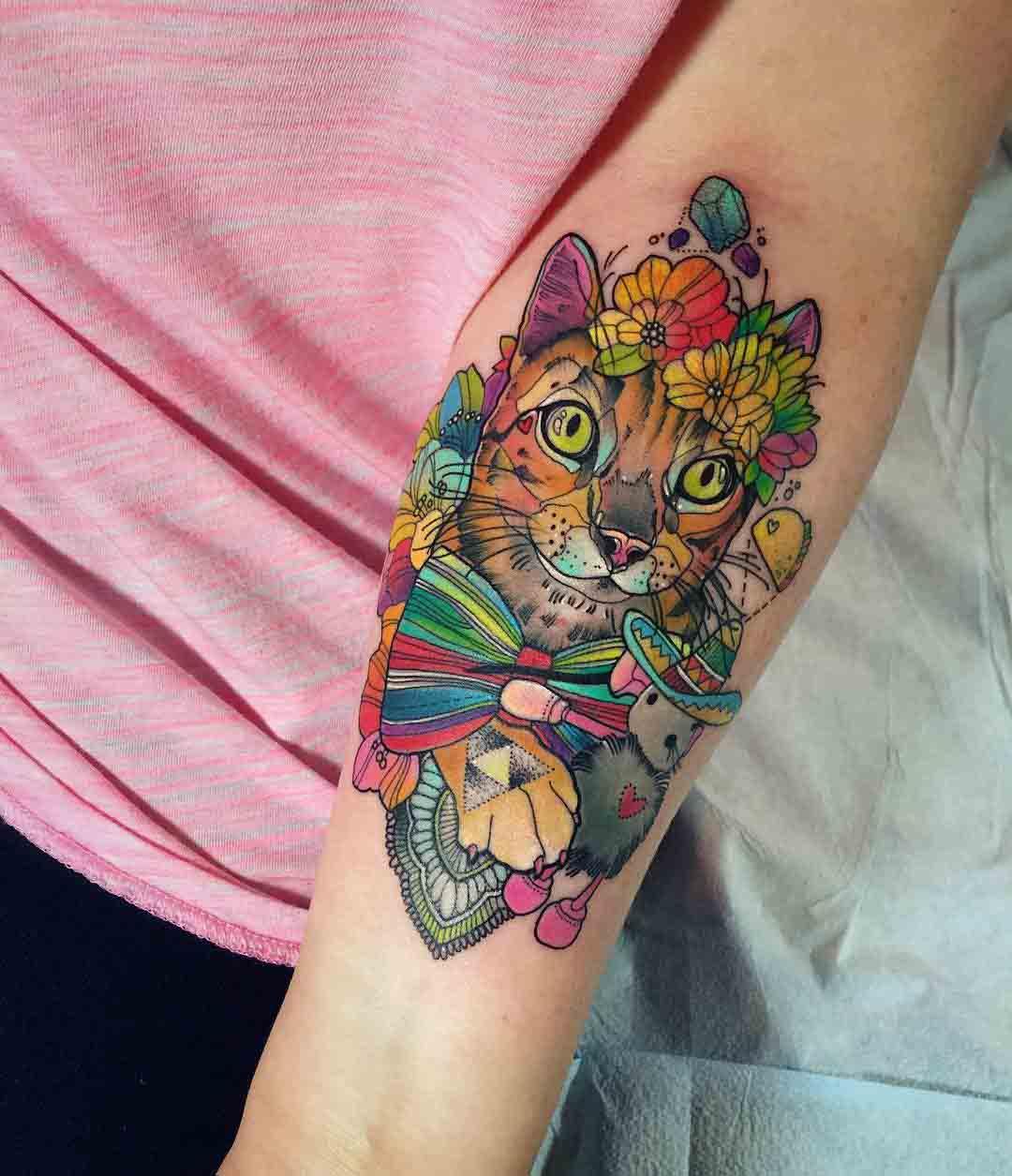 flowers cat tattoo on inner elbow