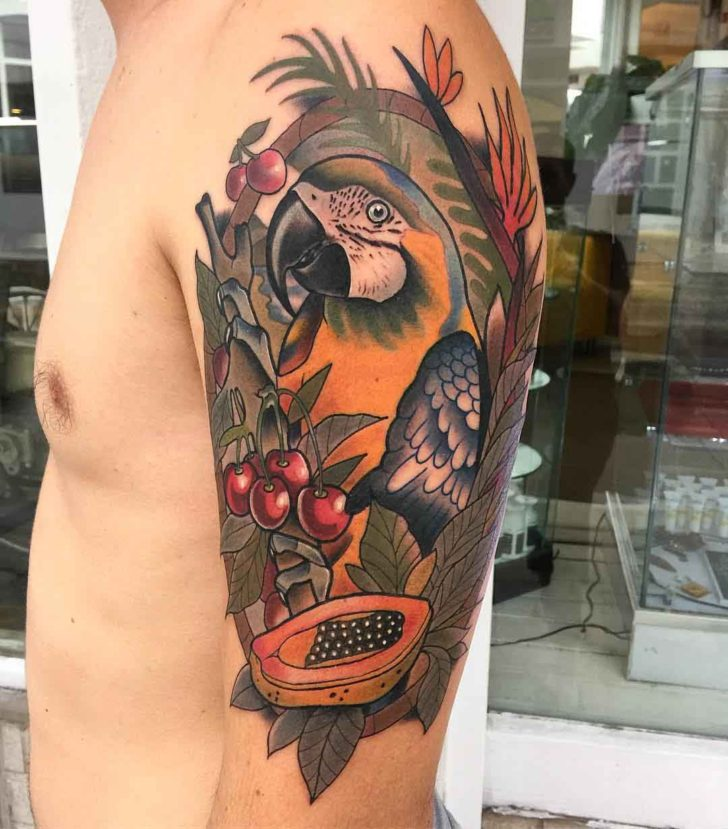 parrot tattoo on shoulder with fruits