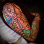new school sleeve tattoo rib cage