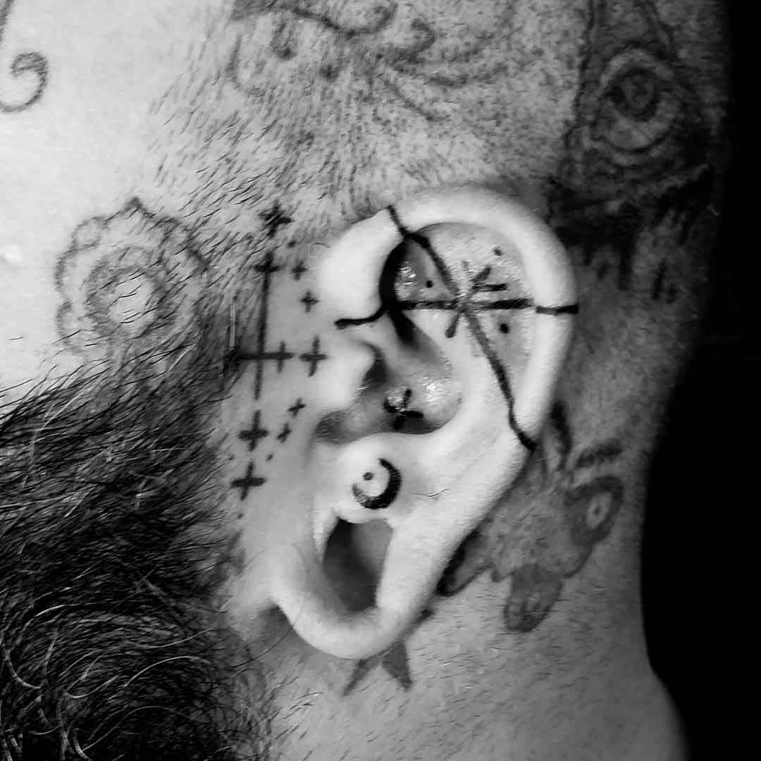 thin lines tattoo on ear