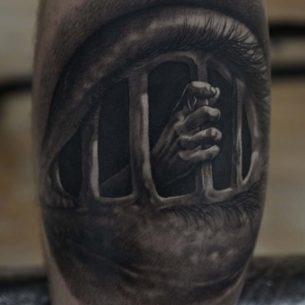 Eye Cage Tattoo