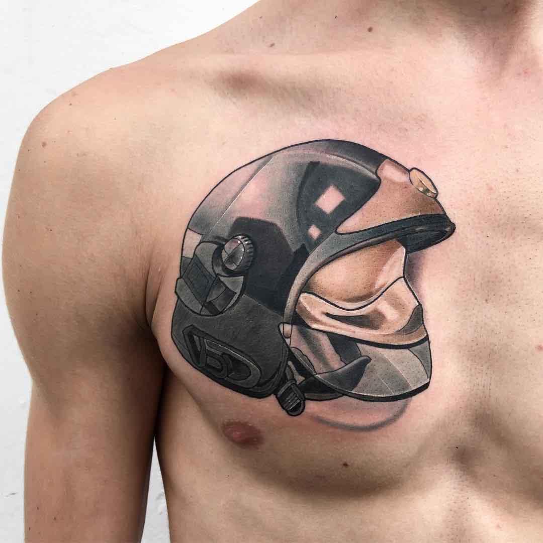 firefighter's helmet tattoo on chest