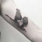 arm tattoo flying bird