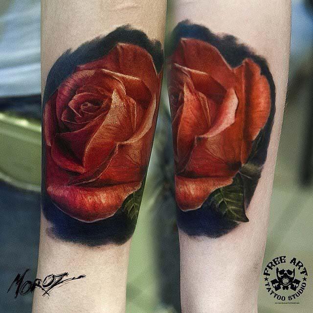 arm tattoo red rose bud