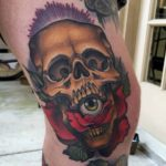 neo-traditional skull tattoo with eye