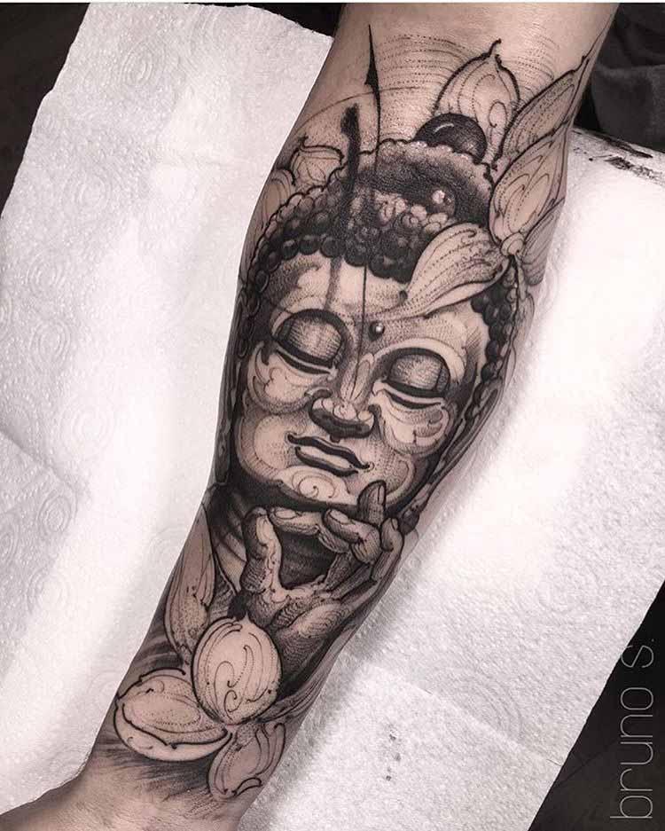 buddha tattoo on arm