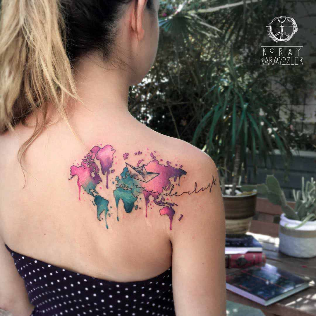 shoulder blade tattoo world map watercolour style