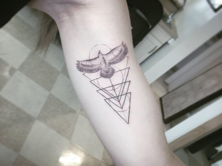 geometrical bicep tattoo bird