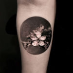 small black and grey flower tattoo