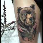 bear tattoo on thigh