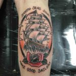 nautical tattoo on calf sailing ship