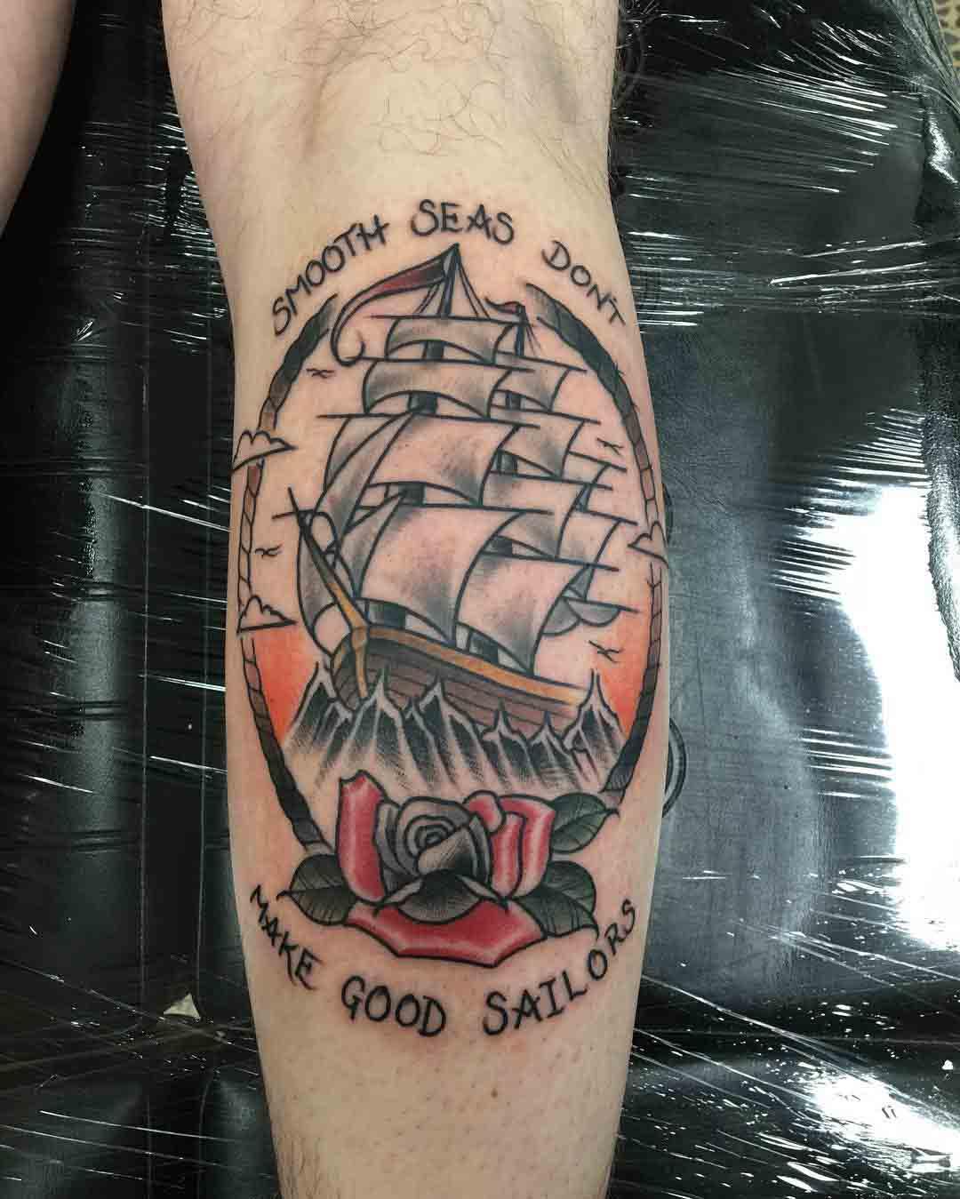 nautical tattoo on calf sailing ship