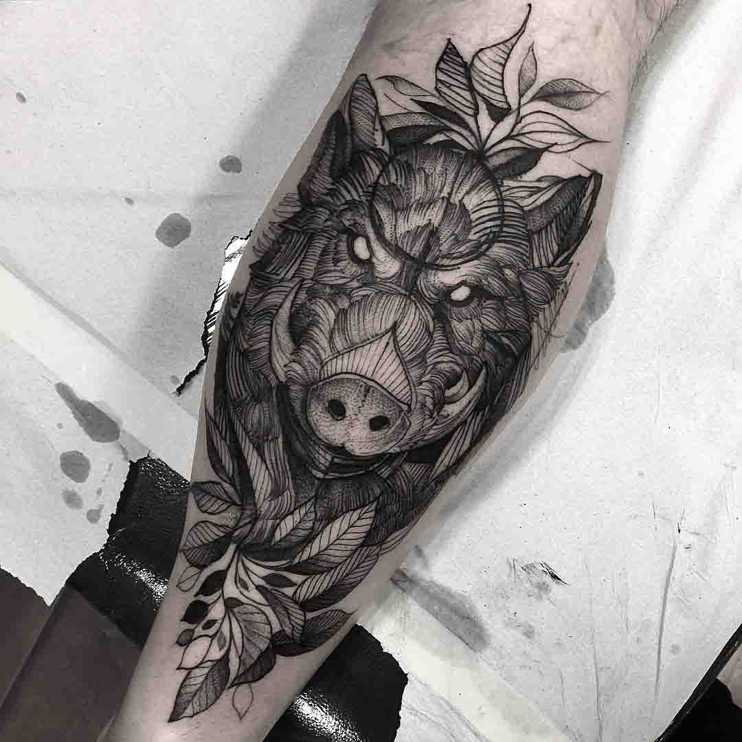 boar tattoo on calf
