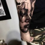 Chicano Face Tattoo on Arm