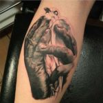 Pigeon in Hands Tattoo on Calf