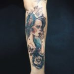 vintage style girl tattoo on forearm