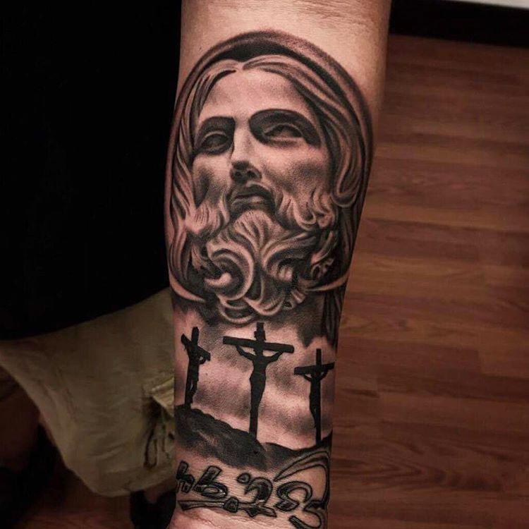 Cruxes jesus tattoo on arm religious