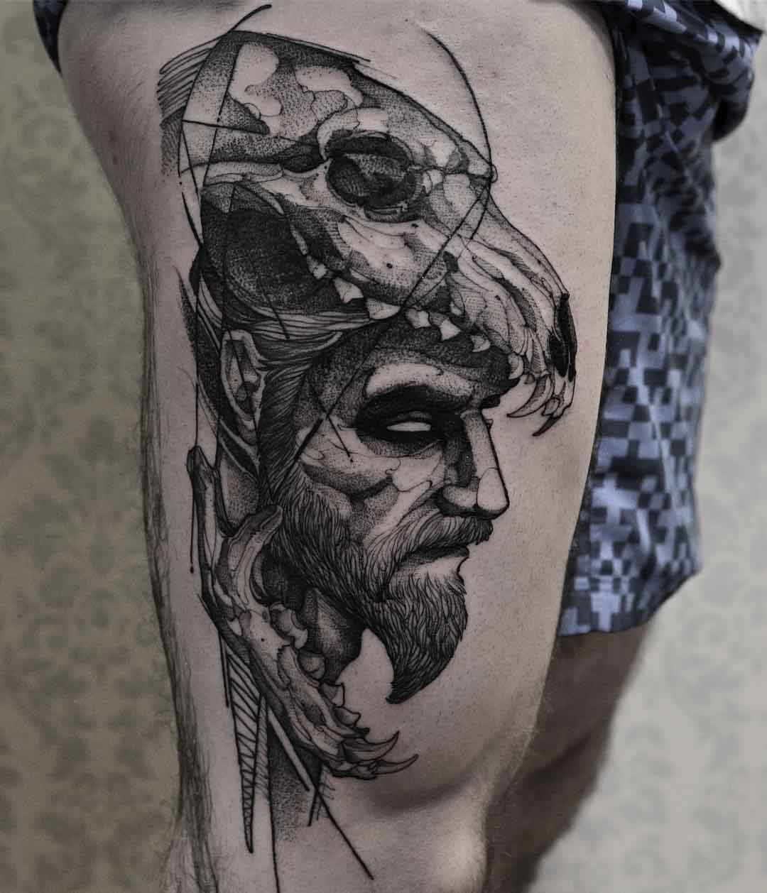 thigh tattoo man in a wolf skull