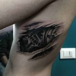 Mechanical Rib Tattoo