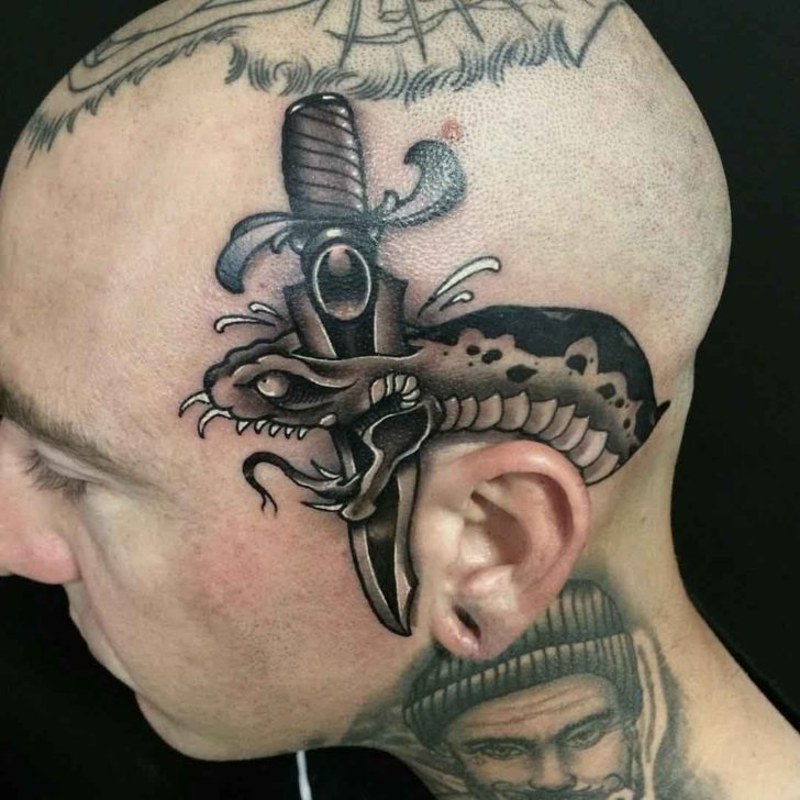 stabbed black snake tattoo on head