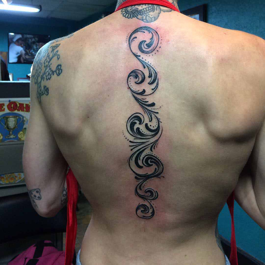 ornament tattoo on spine