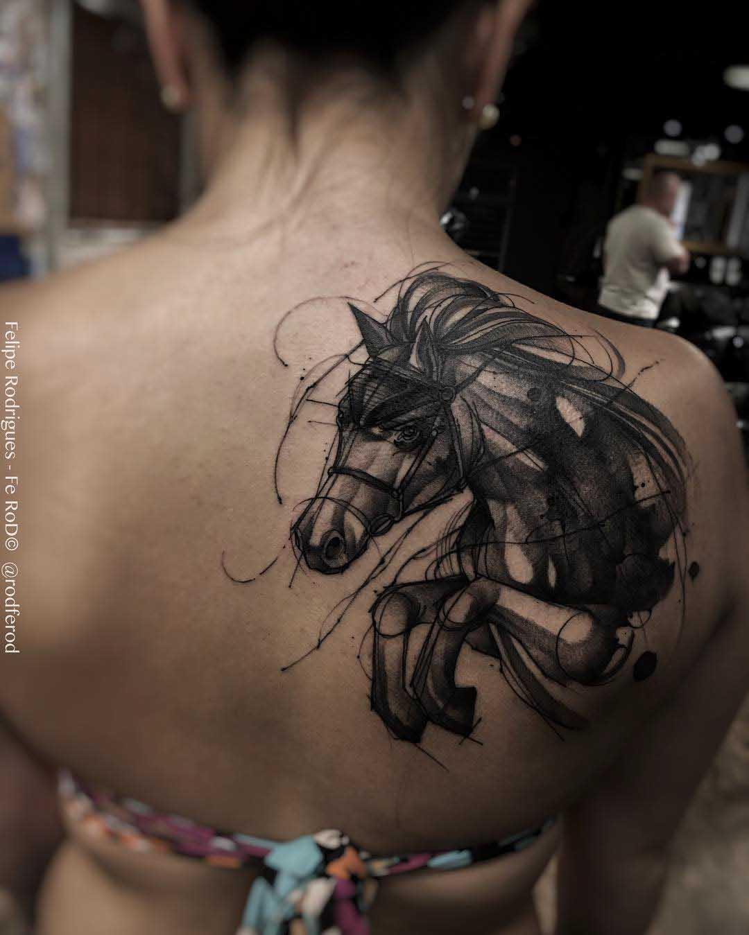 shoulder blade tattoo dark horse