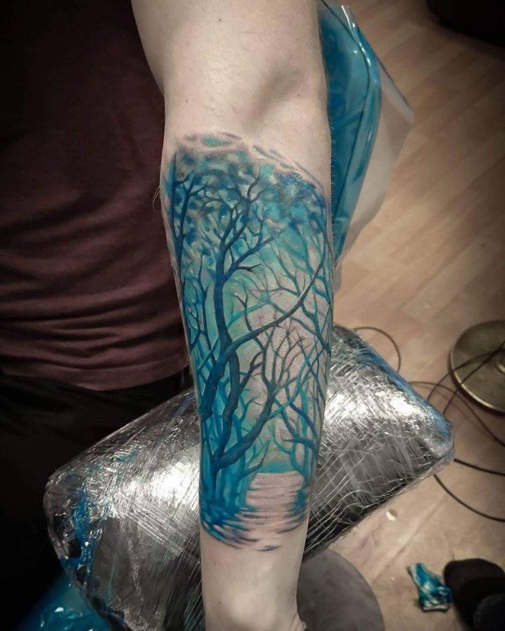 blue forest tattoo by Jari Partanen