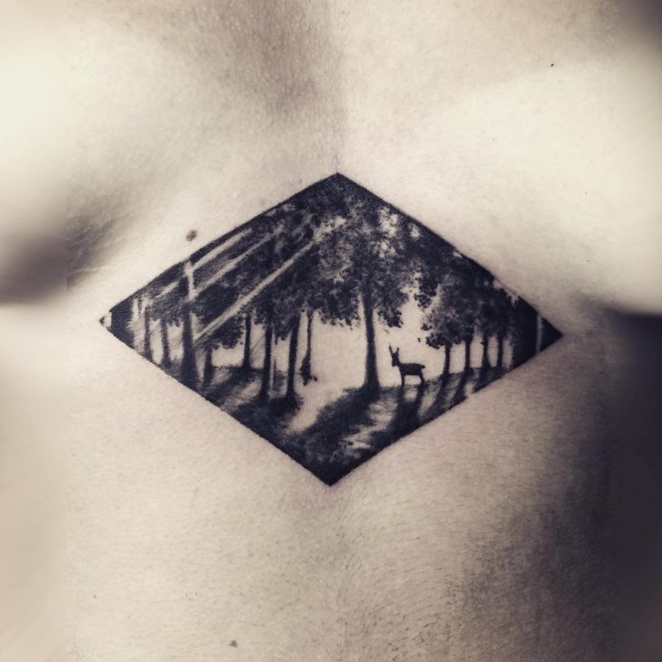 underbreast forest tattoo by hirschtattoolab