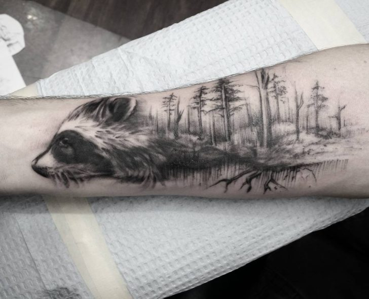 raccoon in forest tattoo by sarah_spread