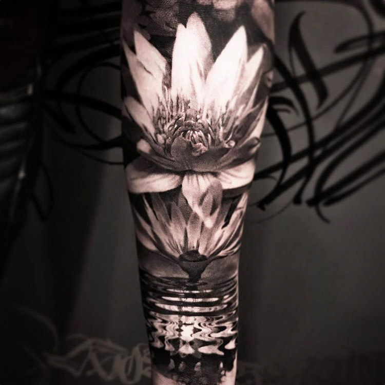 Lotus flower tattoo eD sleeve on arm