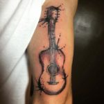 Acoustic Guitar Tattoo on Tricep