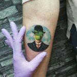 arm tattoo man and apple