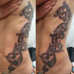 girl side tattoo baroque