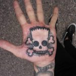 palm tattoo skull of Bart Simpson