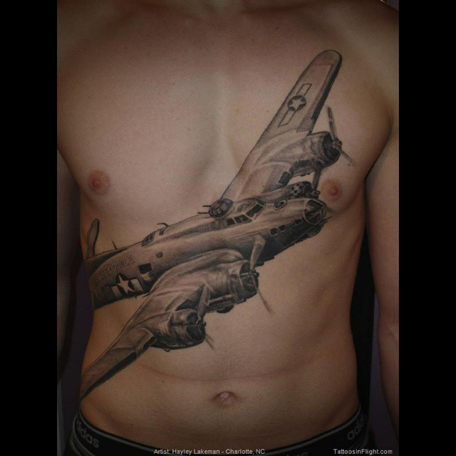 big plane tattoo on torso by hayley lakeman