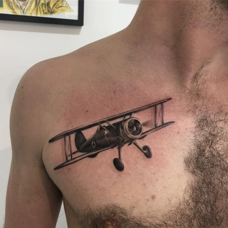 Black and Grey Plane Tattoo on Chest by Jody Lee Knight
