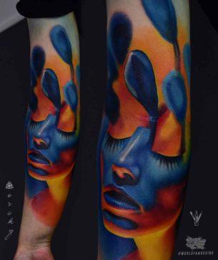 Blue Realistic Tattoo On Forearm