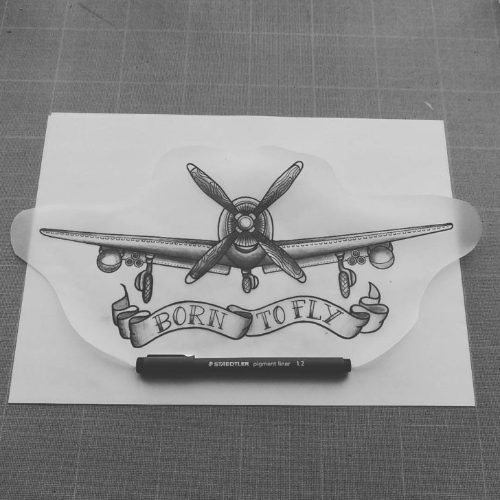 born to fly plane tattoo design with ribbon by swannlpx