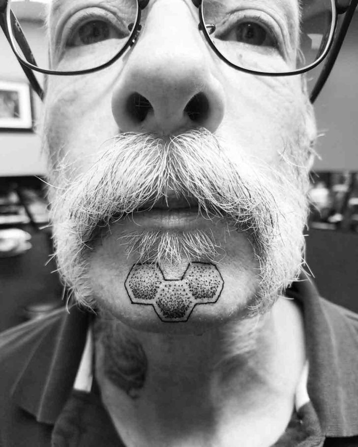dotwork chin tattoo geometric pattern