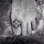 Clover Emblem Toe Tattoo