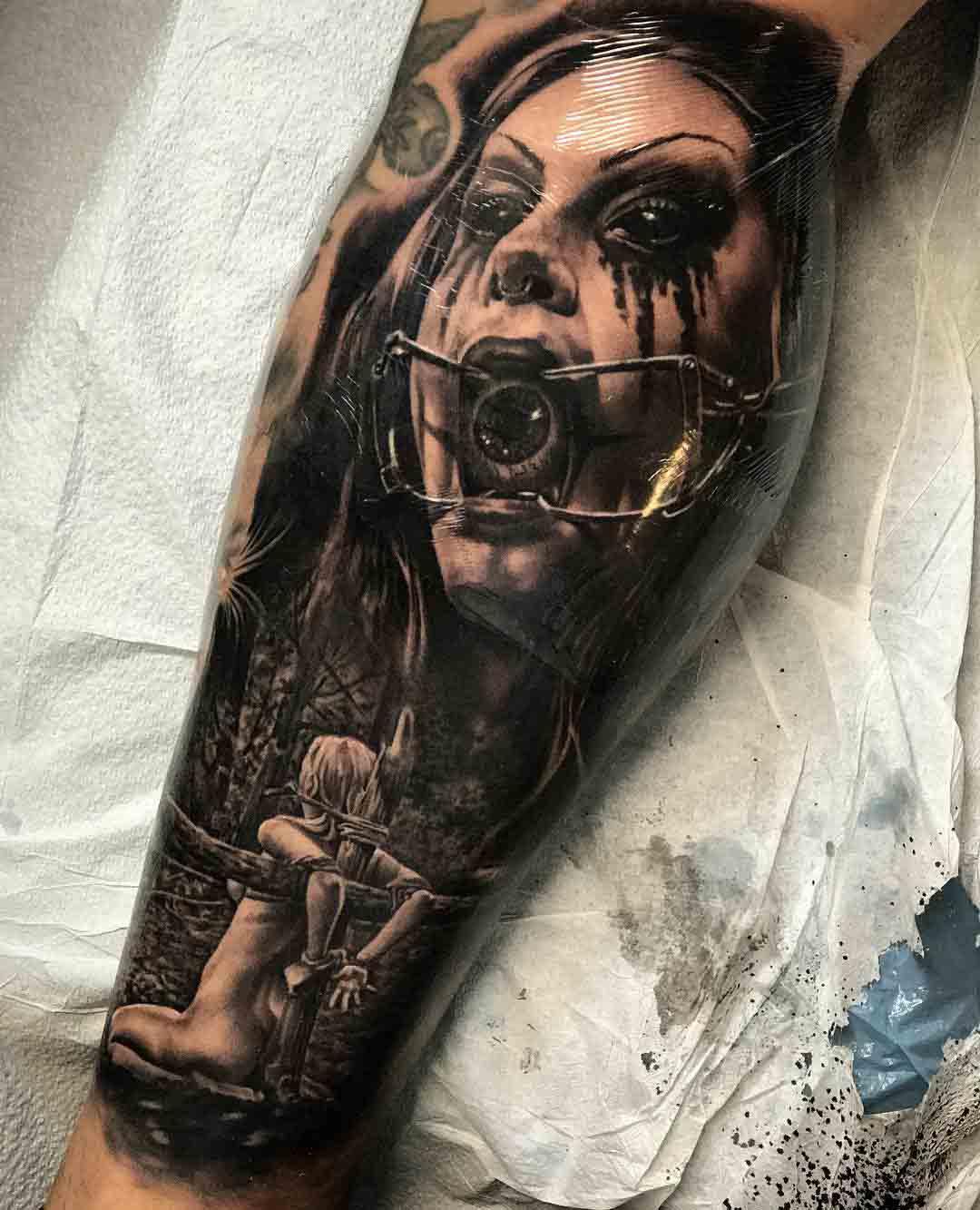inner calf tattoo horror