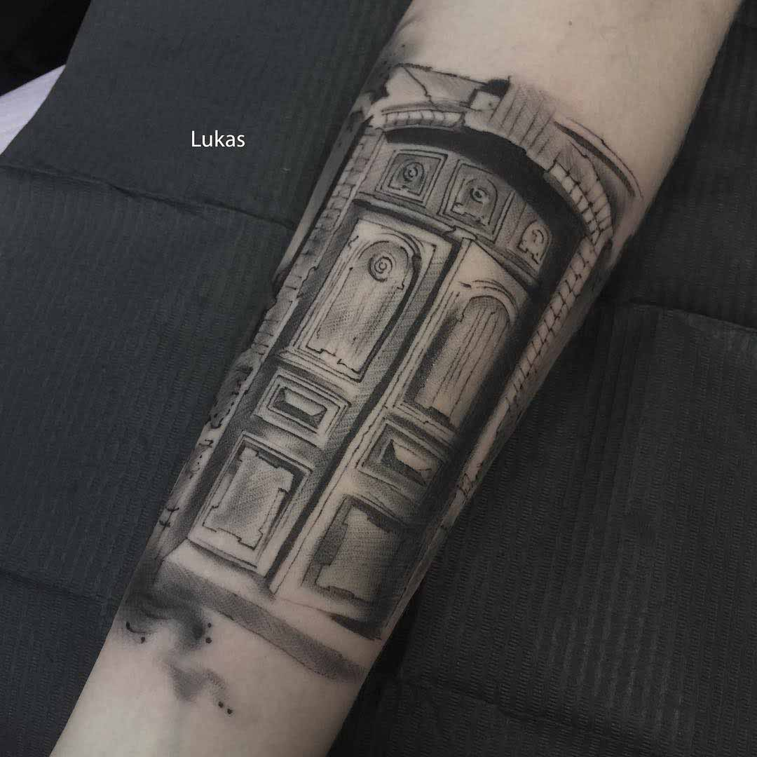 arm tattoo door gate black and grey