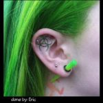 biohazzard sign tattoo on ear