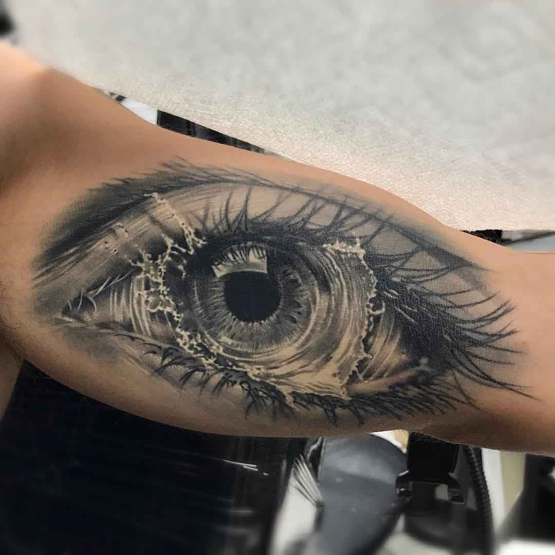 splash eye tattoo on bicep
