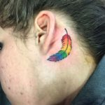 rainbow deather tattoo behind ear very colorful