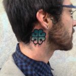 behind the ear clover tattoo upper neck side