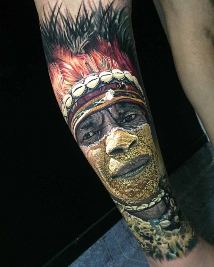 Indian man realistic portrait tattoo on leg