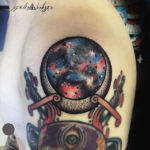 universe moon tattoo on shoulder