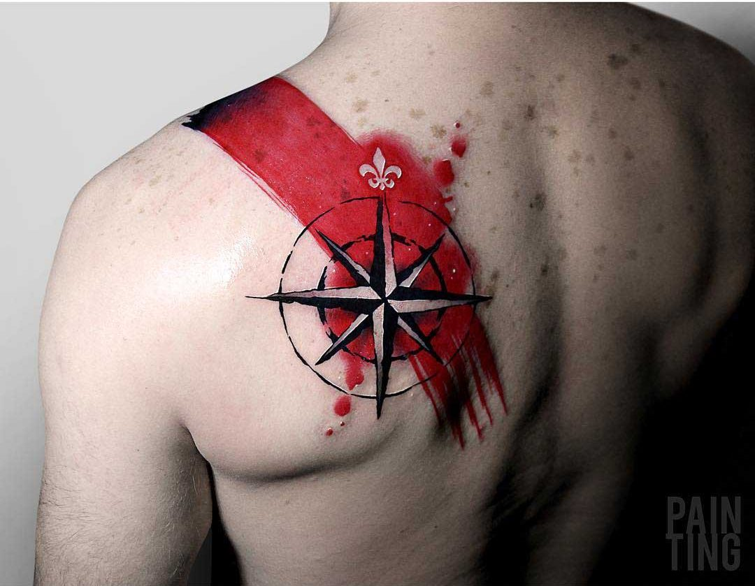 red paint tattoo nautical star on shoulder blade