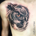 realistic head of owl tattoo on chest